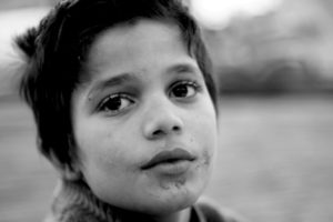 Young refugee child, black and white